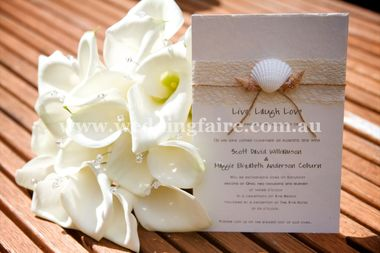 A5 Heavy weight cream card with fine texture topped with naural fibre torn Mulberry paper, cream or natural lattice mesh, sea shells and jute cord.  Options for this invite come in Portrait or Landscape.