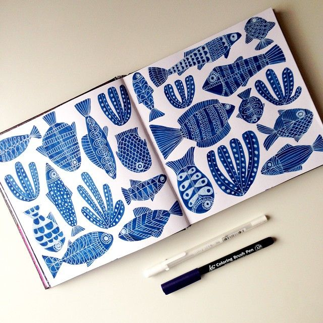 Lisa Congdon's sketchbook spread of fish using a Prussian Blue Koi Coloring Brush pen and White Gelly Roll.
