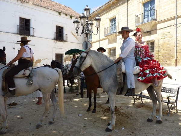 Improve your conversational skills in Spanish fast. Lots of tips and approaches. (photo: Girl in flamenco dress on horseback during local fiesta in Andalusia)