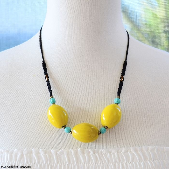 Lemon & turquoise black macrame knotted cord necklace ~ ceramic lemon 35x23mm beads & 7mm fluted turquoise Czech rounds with antique brass & black hemp cord ~ adjustable length 52-56cms