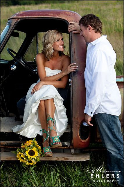 A fun sunflower and hay themed wedding#old trucks #maris_ehlers_photography