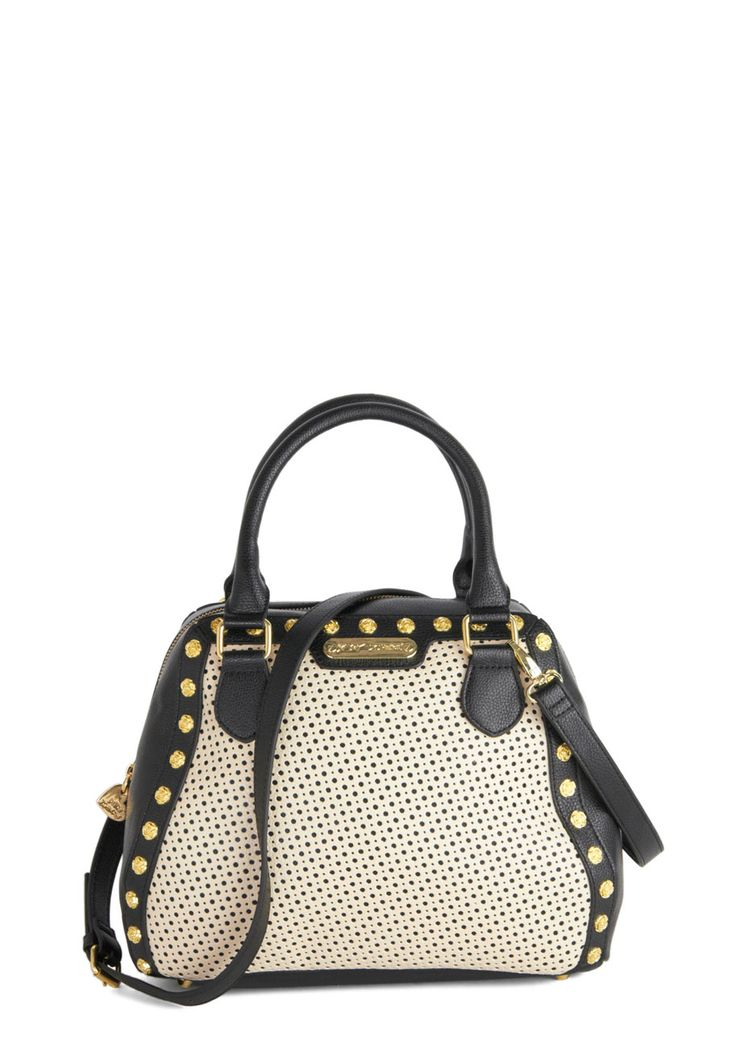 What's black, white, and ivory with studs all over? Your new favorite bag by Betsey Johnson. <3