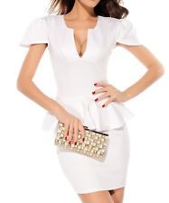 This sophisticated; stylish white peplum dress is perfect for any occasion. It is made of fabric that has a slight stretch to it to give you a perfectly fitted bodycon look. The peplum itself is the ideal embellishment to give you that hourglass silhouette making your waist look more slender that has brought the peplum back into vogue. The neckline has a 'U' cut leading into a deep 'V' to allow for a tiny bit of cleavage, but not so much as to detract from the overall classy look of this…