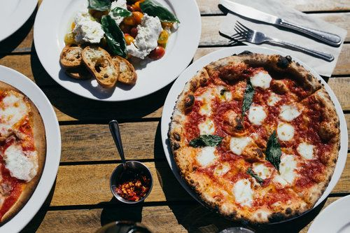 farm fresh tomato salad and margherita pizza at norman hardie winery in prince edward county