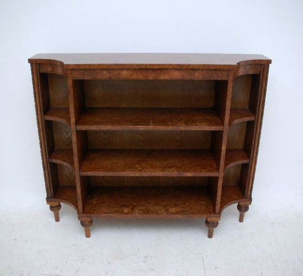 This slim, elegant open bookcase in burr elm, has really tight burrs & is in good condition. It's antique Regency style & has been made by my cabinet maker as an exact copy of a model I had in the past, which was so popular I could have sold it ten times over. I suppose it could be used for books or whatever you like & has a great shape.