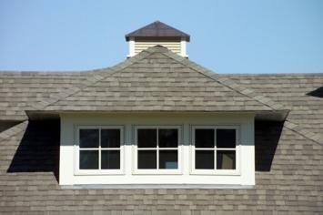 Cool dormer concept. You actually get an additional/higher peak (than with a shed dormer) in the room with an open ceiling, that goes all the way back to the ridge.