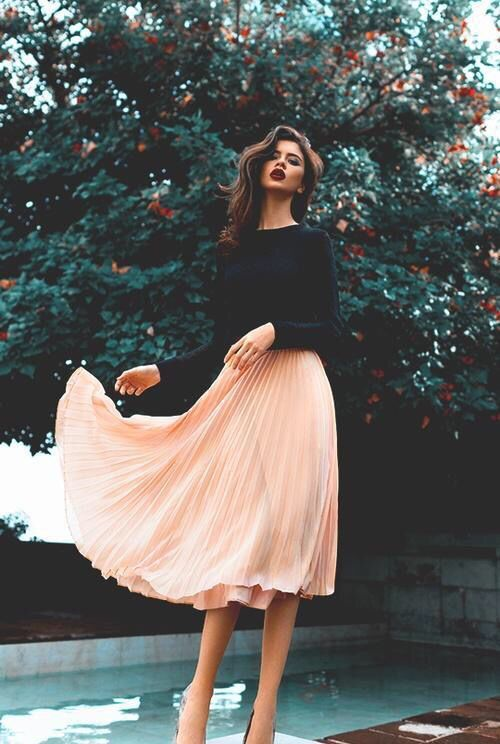 blush pleated skirt and black sweater
