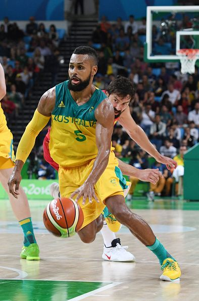 Australia's guard Patty Mills runs past Spain's guard Sergio Llull during a…