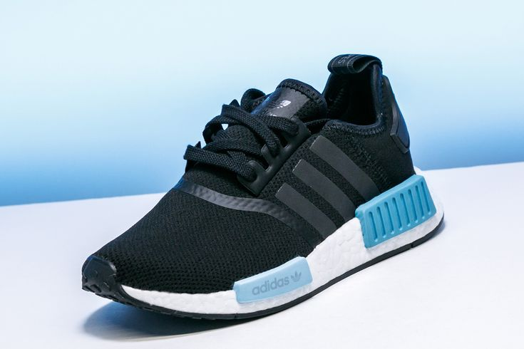 The black mesh upper and bumpers in two hues of blue make this women's exclusive adidas NMD_R1 a sick summer shoe.