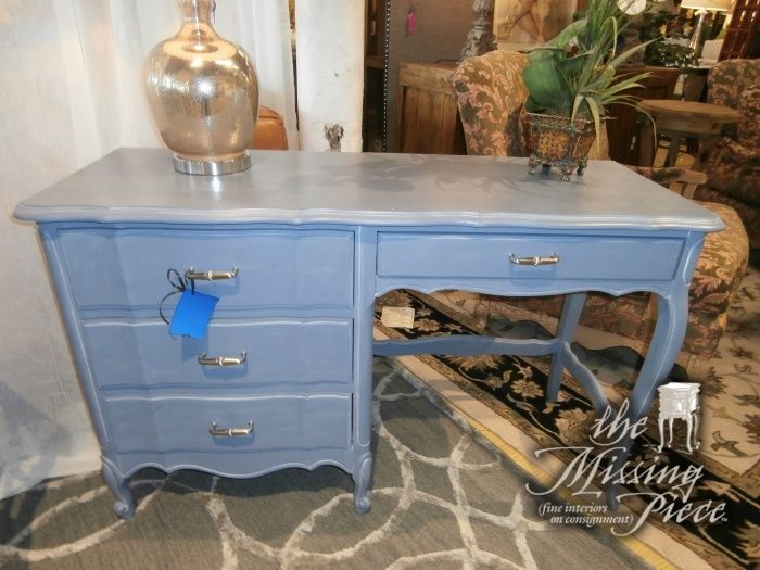 Sit at this desk and feel the Mediterranean breeze of the French Riviera on your cheeks. French provincial desk in blueish gray mist. Measures 47 x 19 x 30.