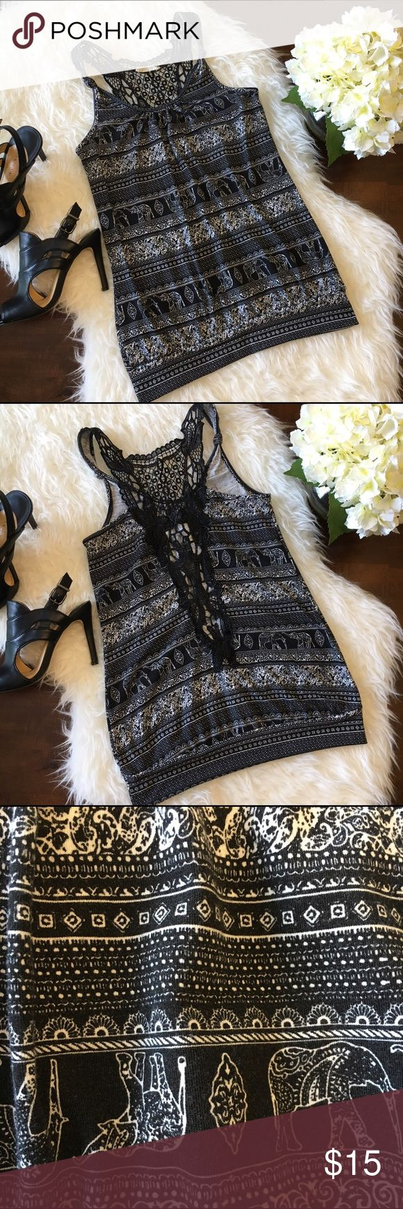 """Black & White Elephant Print Crochet Back Tank Top Great used condition. Super cute black and white elephant and paisley print racerback crochet back tank top. Cute knotted detail on shoulder straps. No size tag but fits like a small. Armpit to armpit: 16"""", shoulder to hem: 25"""". No tears, holes, or stains. Smoke free home. No trades please. Tops Tank Tops"""