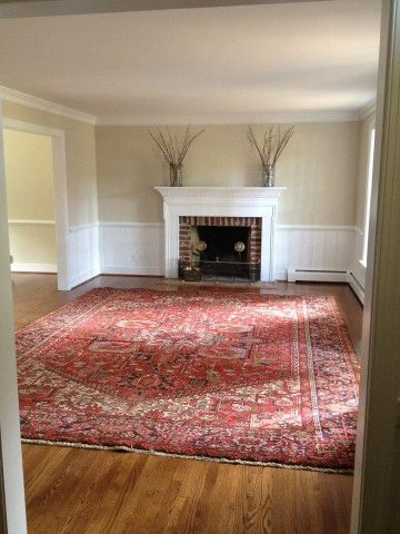 (BrandonRugs.com) Select a real hand-knotted oriental rug (this one is a Persian Heriz; made in Iran) as a starting point for the furnishing of your room, and you might realize that it's possible to forego a lot of the other stuff you thought you'd need to make the room complete.