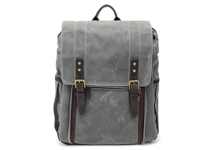 Handsomely crafted with waxed canvas and detailed with dark truffle leather, the Camps Bay camera backpack is designed to hold a camera with a 70-200mm f/2.8 lens attached, up to seven additional lenses, most 17-inch laptops and small personal items. All interior dividers are completely  removable and adjustable to accommodate your gear. A special divider at the top of the bag creates a space of 4