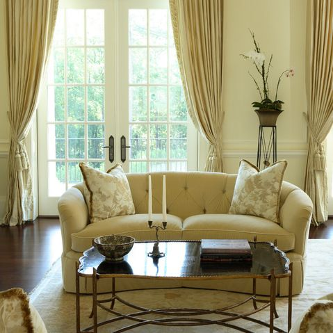 Creams and golds with warm wood floors and a vintage coffee table.