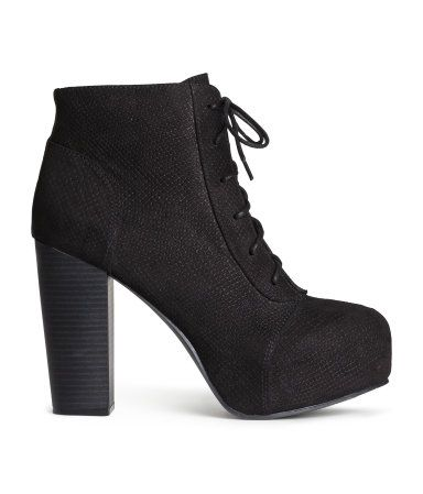 Ankle boots in imitation suede (black in imitation leather) with laces at front. Front platform height 1 1/2 in., heel height 4 1/4 in. Rubber soles.
