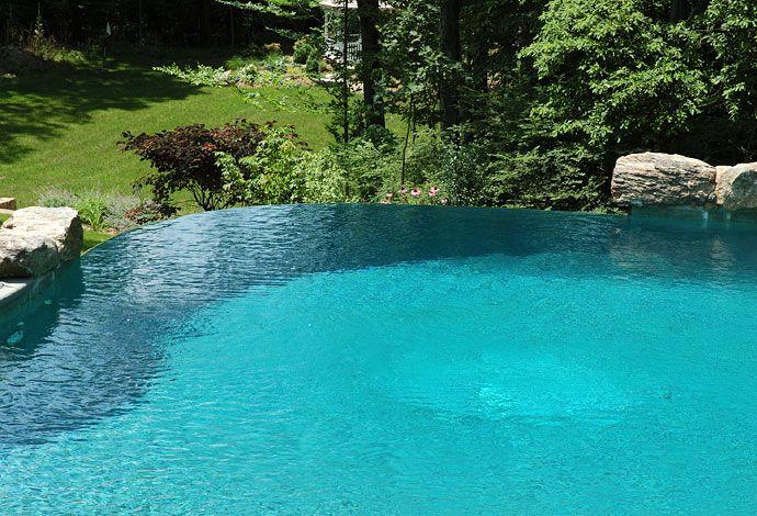 Vanishing edge swimming pool with natural stone