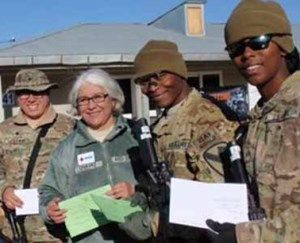 """Send a holiday card to a soldier overseas through the Red Cross' """"Holiday Mail for Heroes"""" program."""