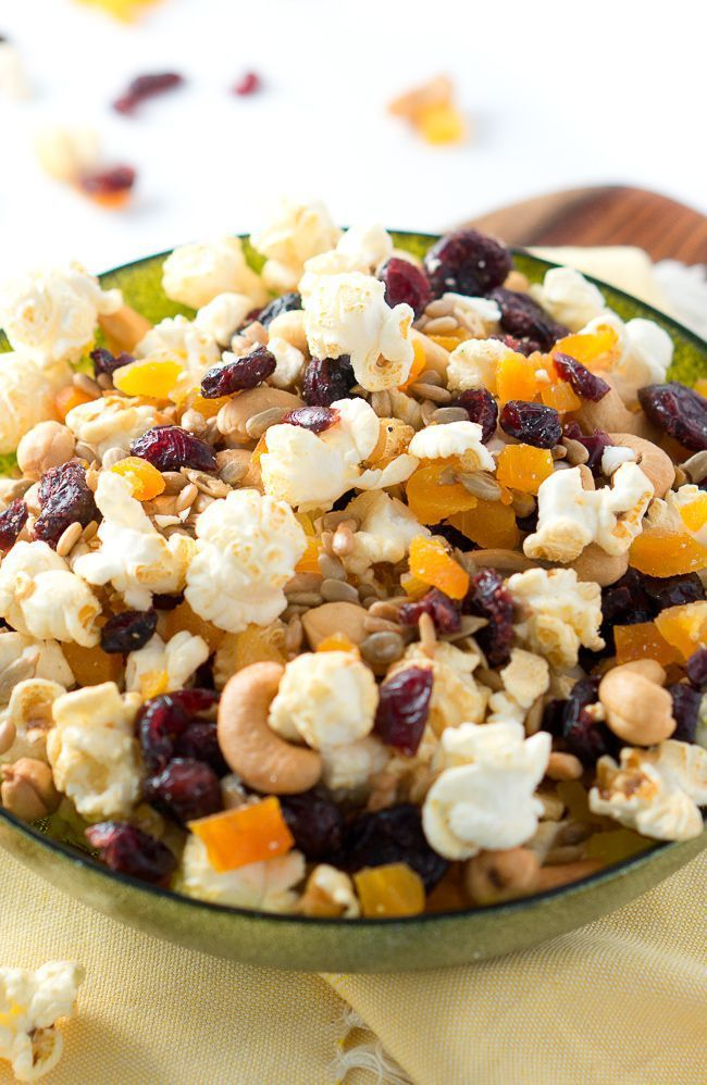 Sweet and salty- this healthy popcorn trail mix has it all! Perfect for Game Day, a party and any holiday! So easy too! #superbowl #gameday #popcorn #trailmix