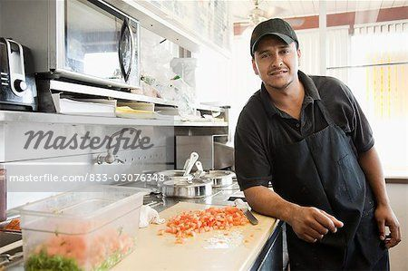 Hispanic cook in diner kitchen Stock Photo - Rights-Managed, Image code: 833-03076348