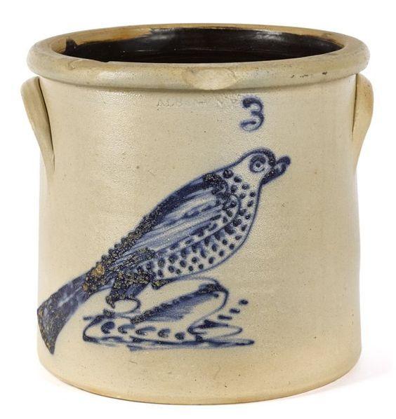 New York stoneware crock, 19th c., impressed Albany N. Y., with a cobalt bird on a stump, 10 1/2'' h.
