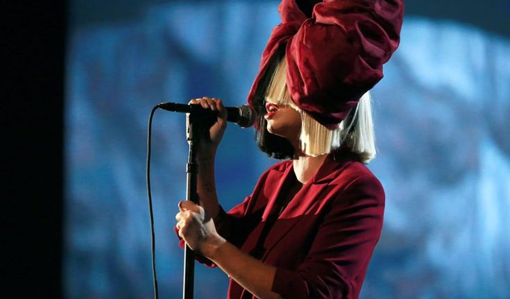 LOS ANGELES, CA - NOVEMBER 18: Recording artist Sia performs onstage at A+E Networks ' Shining A Light' concert at The Shrine Auditorium on November 18, 2015 in Los Angeles, California. Description from latinpost.com. I searched for this on bing.com/images