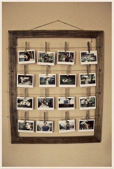 I might have to do this at school! I have a blank frame on top of a bookshelf and leaning against a wall. The class photos are taped to the wall. This would be much nicer!
