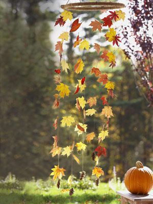 """Hanging Autumn leaf """"wind chime"""". Pic only unfortunately. Would probably use fake leaves, and maybe Autumn colored beads in between to add weight to keep strands hanging properly..."""