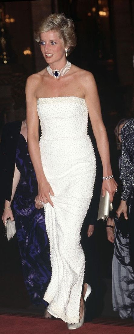 Beautiful Princess Diana in a timeless white evening gown. She knew flawless fashion.