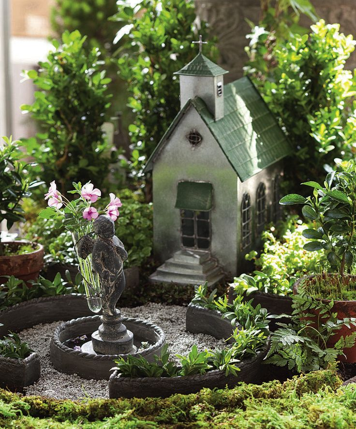 Jeremie   Miniature garden classic tin church with planters for boxwood cuttings and angel statue flower holder.