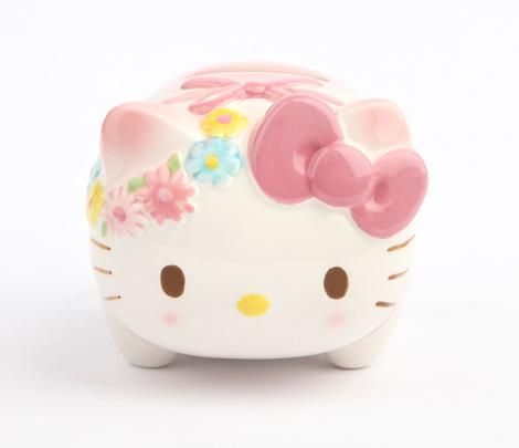 "Hello Kitty Mini Coin Bank: Daisy Chain ~ ""A stunning display piece or gift, this little Hello Kitty Piggy Bank will inspire young savers. Just like the coin banks of old, this is glazed ceramic and has Hello Kitty wearing a delightful daisy chain. So cute!"" ~ This would make such a cute Easter basket addition!"