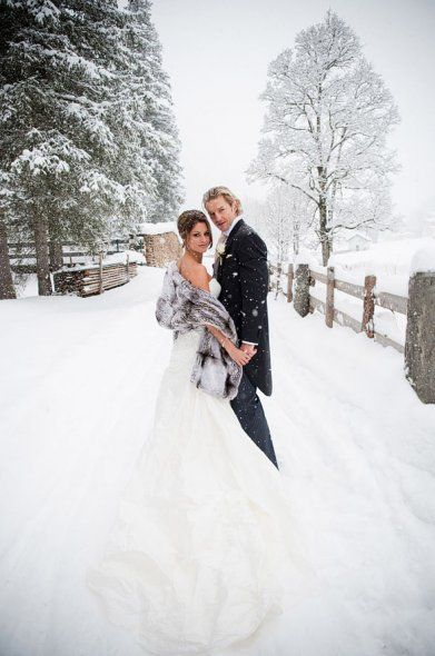 Beautiful shot of the bride and groom in the snow. Love the grey fur wrap, it contrasts beautifully with the white snowy surroundings.