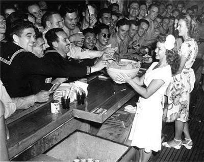 1944 - Shirley Temple lending a hand at the USO