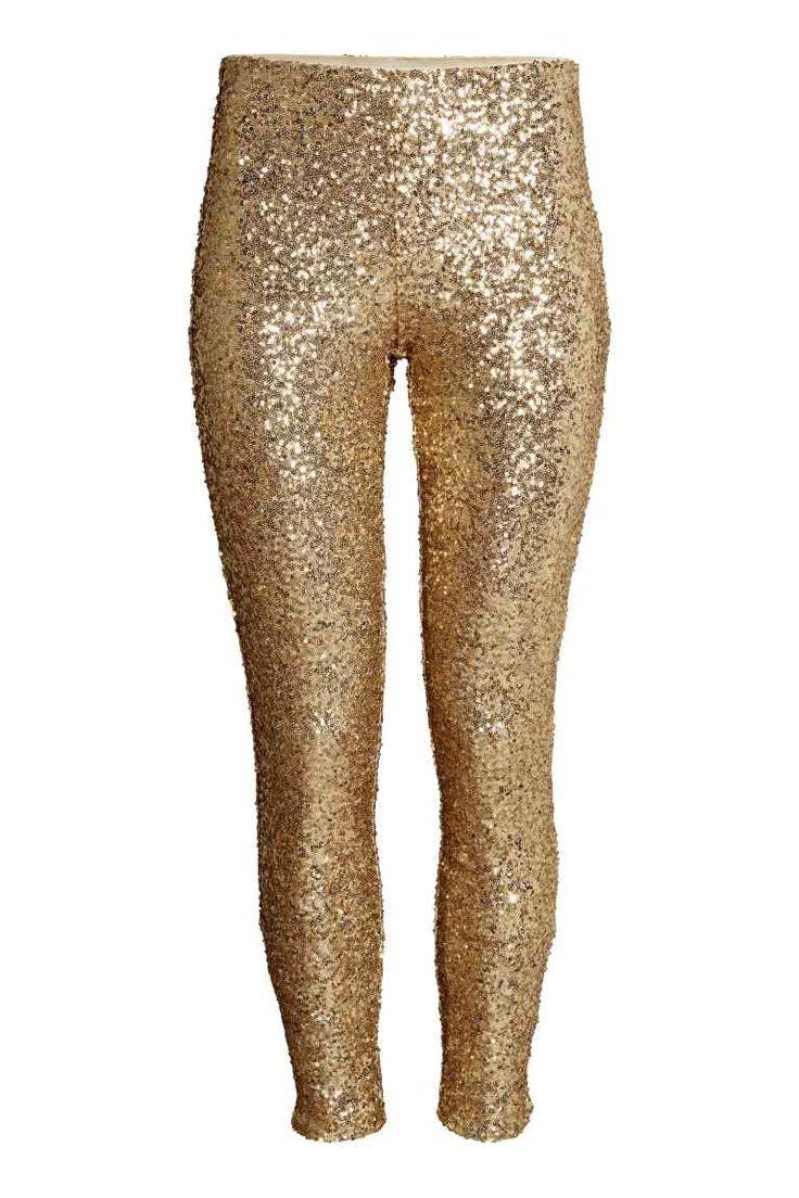 Pantaloni con paillettes: Pantaloni in mesh rivestiti di paillettes. Gamba strettissima e vita alta. Elastico in vita e cerniera nascosta sul fianco. Fodera in jersey.