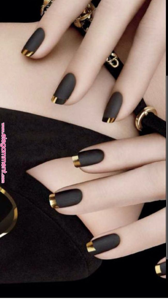 Black nails and gold tips