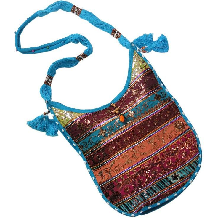 This Rajasthani shoulder bag in luscious colours is showing colours of our tradition. This designer hand bag is adorned with intricate sequin work in stripes. The slight curve at the lower part of the bag is making it a designer piece. It has a blue shoulder sling which is graced with tassels and border. The colourful sequin work decorated on the bag. Visit for but this Awesome bag:-http://khoobsurati.com/khoobsurati/designer-sequin-work-ladies-blue-shoulder-bag-117-khoobsurati