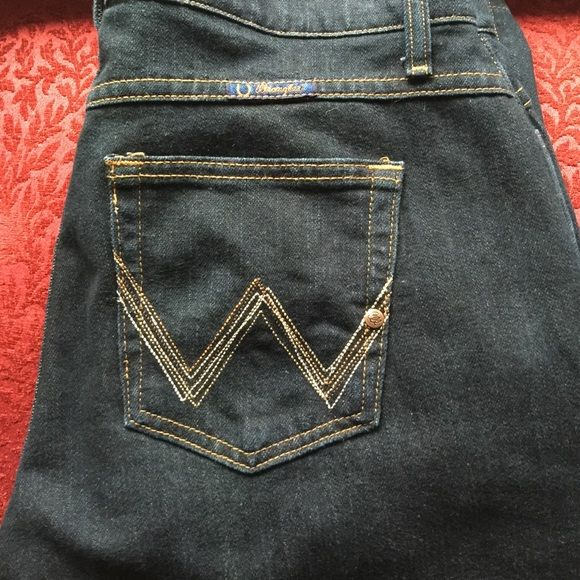 """Wranglers jeans Wranglers jeans, dark navy, barely worn, excellent condition. 13/14, length 34, I tried them on and I'm a 14, with a 31/32"""" length, they fit and didn't hang on the floor. Wrangler Jeans Boot Cut"""