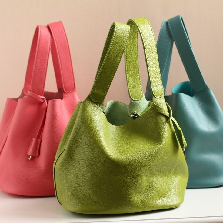 The new candy-colored leather tote first layer of leather handbags lock portable bucket cute handbag little lunch bag founder $200.00