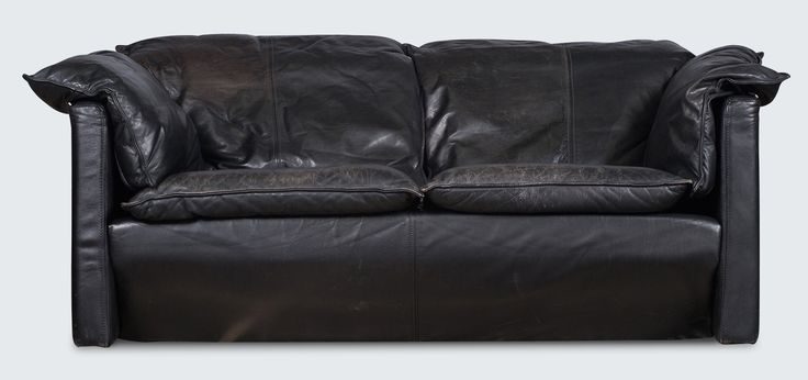 Sink into this beautiful sofa by Niels Eilersen! The luxurious black leather has the perfect patina, and all the style of a modern Danish sofa. Beautiful centre front seam top stitching on the cushions and sofa base are stunning details and all the more reason to fall in love with this piece. With the Eilersen-style overlapping cushions, this is a sofa for both comfort and mid-century modern style.