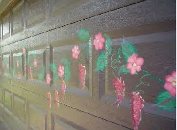"""This is a mural I painted on my garage door.  I used just patio paints,  freehand.  The flowers are painted in Donna Dewberries """"one stroke"""" technique."""