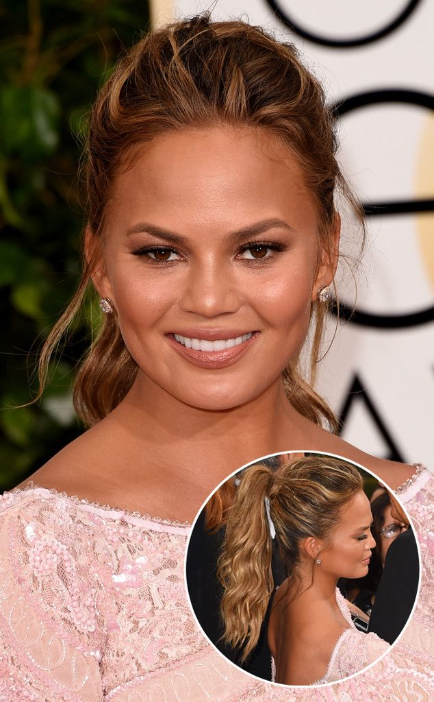 Here's a classic case of casual glamour: Chrissy Teigenpaired her Couture gown with a easy, breezy ponytail.