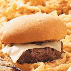 """Swiss Steak Burgers Recipe -""""If you're hungry for steak, but all you have is ground beef, these hearty burgers will hit the spot."""" In just 20 minutes and with only five ingredients, who would believe you could have a restaurant-quality burger? Greg Dalenberg - Peoria, AZ"""