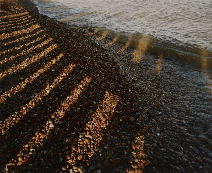 Wave breaking on shingle shore by Fay Godwin - British Library Prints