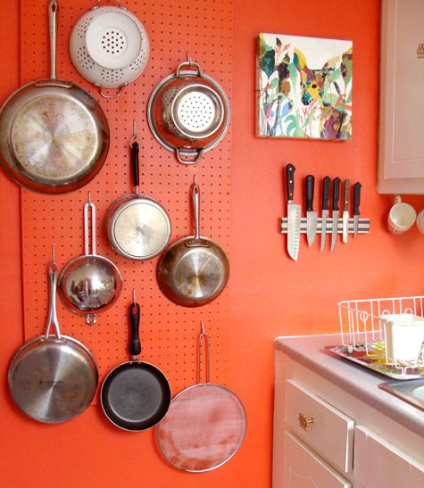 DIY Pegboard: When painted the same color as the wall it blends right in. Perfect storage idea for a small kitchen / http://decoratingfiles.com/category/diy/page/4/