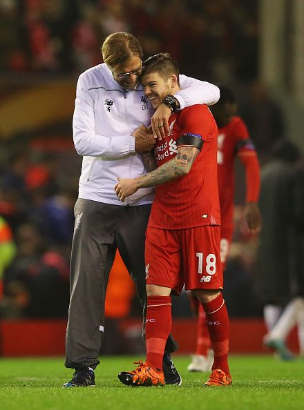 Jurgen Klopp manager of Liverpool embraces Alberto Moreno of Liverpool after victory in the UEFA Europa League Group B match between Liverpool FC and...