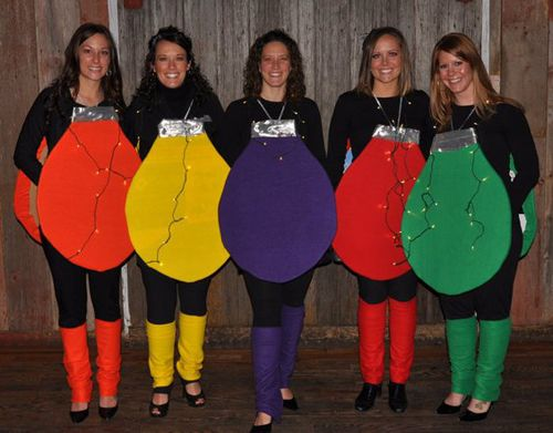What a creative set of costumes! You don't have to go overboard with expenses to have fun Christmas inspired costumes. This will really light up a room.