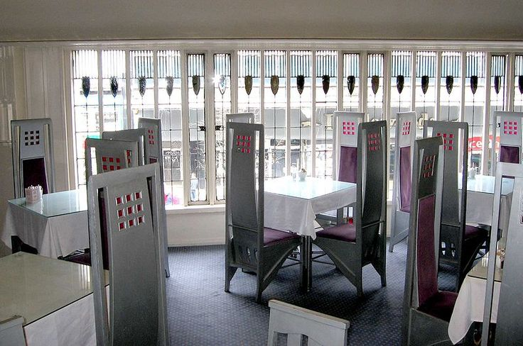 The Room De Luxe in The Willow Tearooms in Glasgow. It was designed in collaborations with Mackintosh's wife Margaret MacDonald for tea room owner Catherine Cranston. Is famouse for its glass window. The chairs, tables, and coat rack is silver painted oak furniture.