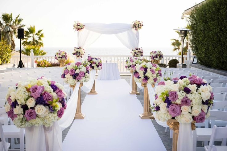 Outdoor Ceremony with Purple Flowers at Shutters on the Beach Wedding Venue | Photo courtesy of Shutters on the Beach. Read More: https://www.insideweddings.com/news/planning-design/say-i-do-on-the-california-coast-at-shutters-on-the-beach/3083/