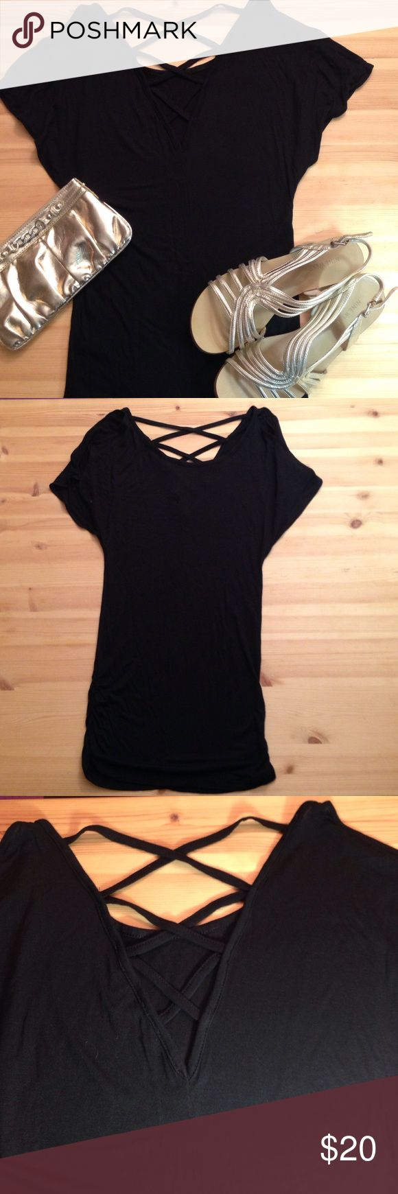 Express Long Shirt Express Long Shirt - Black - Never Worn - has slits in sleeves and cross-cross strapped back - This extra long top is the perfect length for leggings! Express Tops Tunics