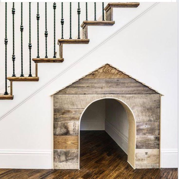 Adorable dog house under the stairs.....
