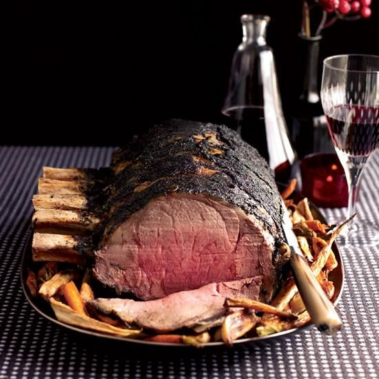 Three-Ingredient Prime Rib Roast | Coffee and prime rib seem like unlikely partners, but Ryan Farr's recipe reveals they both have an earthy quality that makes them a natural match. Just be sure to scrape off any excess coffee rub from the meat before serving.